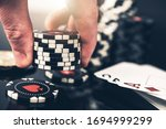 Poker Player Placing Bid Closeup Photo. Gambling Industry Concept with Casino Chips. - stock photo