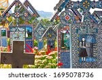 Small photo of Romania, Sapanta, Maramures county, August 29,2010:Merry Cemetery famous for the vividly colored tomb crosses and the naive paintings