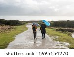 Two Women With Umbrella In Par...
