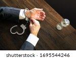 Hands Unfasten The Handcuffs....