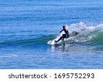 Surfer Cutting Back On A Sunli...