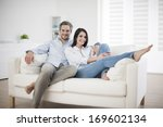 couple at home relaxing in sofa | Shutterstock . vector #169602134