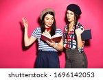 Two Caucasian Brunette Hipster...