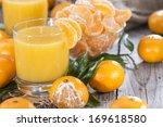 portion of fresh made tangerine ... | Shutterstock . vector #169618580