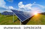 Small photo of Solar panels on the sky background. Solar power plant. Blue solar panels. Alternative source of electricity. Solar farm.