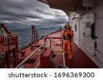 A Man In Ship's Fire Outfit On...