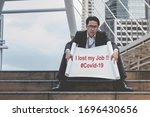 Small photo of Covid stress unemployment businessman failure lost job from coronavirus epidemic crisis. Business man holding sign of lost job due to covid-19. Stress man unemployed Jobless lay off despair stressful