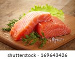 Stock photo fresh raw salmon on wooden cutting board 169643426