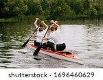 four man athletes canoeist paddling in canoe on lake