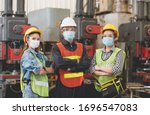 Small photo of Group of Asian male and female engineers wearing hygienic mask protect with helmet safety in factory Industrial.Coronavirus Protective, safety concept