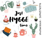 just hygge time. cozy home. let'... | Shutterstock .eps vector #1696576576