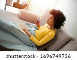 Relaxed Young Woman Reading A...