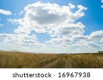 steppe way and clouds - stock photo
