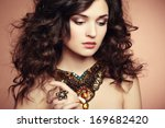 portrait of beautiful brunette... | Shutterstock . vector #169682420