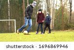 family plays football on the...   Shutterstock . vector #1696869946
