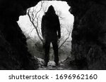 A Scary  Hooded Figure Standing ...