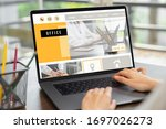 business woman using website on ...