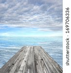 wooden pier on sunny day with...   Shutterstock . vector #169706336