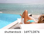 beautiful woman in blue bikini... | Shutterstock . vector #169712876