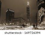 TAIPEI, TAIWAN - Dec. 28 2013. Famous landmark, the 101 skyscraper with city street in a rainy night, Taipei, Taiwan, Asia. Dec. 28 2013. - stock photo