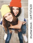 two young hipster girl friends... | Shutterstock . vector #169737620