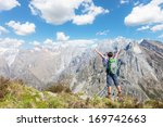 happy young woman at top of the ... | Shutterstock . vector #169742663