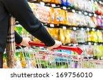 lady pushing a shopping cart in ...   Shutterstock . vector #169756010