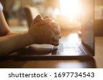 Hand Praying With Laptop ...