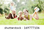 happy family of four on grass... | Shutterstock . vector #169777106