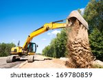Heavy Excavator Unloading Sand...