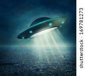 ufo flying in a dark sky | Shutterstock . vector #169781273