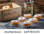 Falling icing sugar on fresh donuts - stock photo