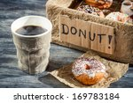 Closeup of hot coffee and box with donuts - stock photo