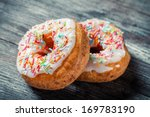 Closeup of donuts with color glaze - stock photo