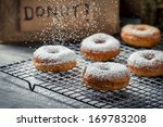 Donuts decorated with icing sugar - stock photo