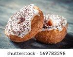 Closeup of donuts with chocolate glaze - stock photo
