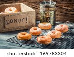 Preparing to decorate donuts with powder sugar - stock photo
