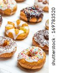 Freshly baked colorful donuts - stock photo