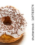 Fresh donut decorated with chocolate - stock photo