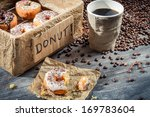 Fresh donuts to take away with coffee - stock photo