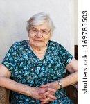 happy senior woman relaxing in...   Shutterstock . vector #169785503
