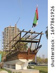 Small photo of Sharjah, United Arab Emirates - April 8, 2020: Traditional Arab fishing boat made of handcrafted wood at Sharjah Maritime Museum. The museum features Emirati seagoing heritage, culture and equipment.