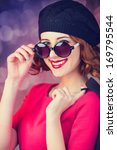 redhead in sunglasses on red... | Shutterstock . vector #169795544