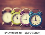 Retro Alarm Clocks On A Table....