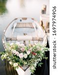 Flowers on white rowboat ...
