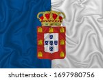 Portugal historical country flag (1830–1910) on wavy silk textile fabric background.