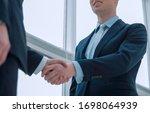 Handshake Of Business Partners...