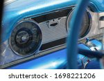 Classic Buick automobile blue interior dash and instrument cluster with speedometer and steering wheel. - stock photo