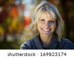 woman smiling at the park | Shutterstock . vector #169823174