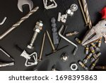 Small photo of group of drill bits, screws, screwdriver bit bits and hexagon wrench for repair
